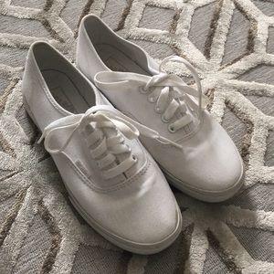Vans white laced shoes